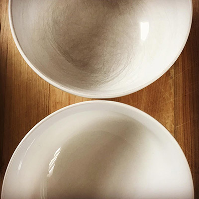 Clean black marks off plates using Bar Keepers Friend