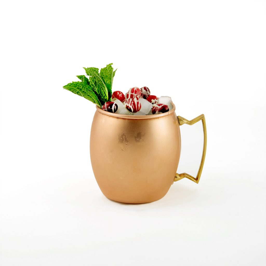 Shiny copper mug with Mule-jito beverage