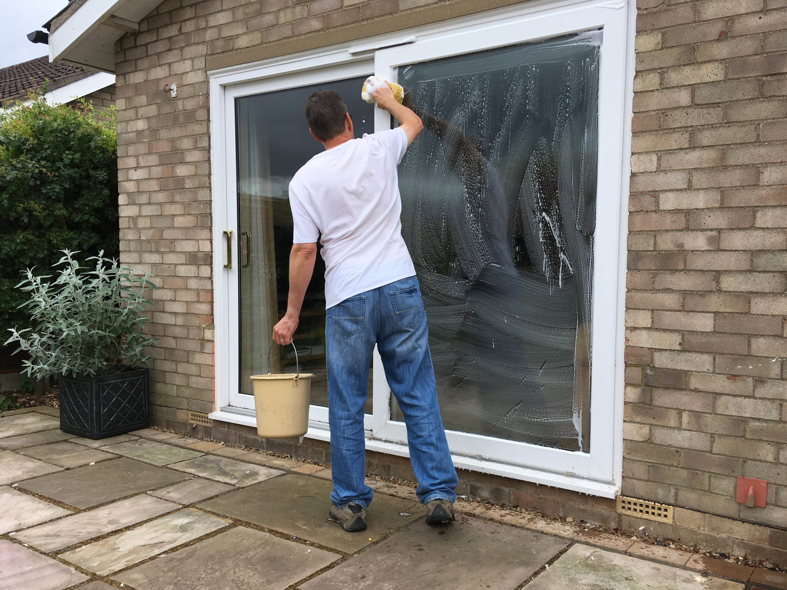 summer cleaning tips - image 2 - cleaning sliding patio doors